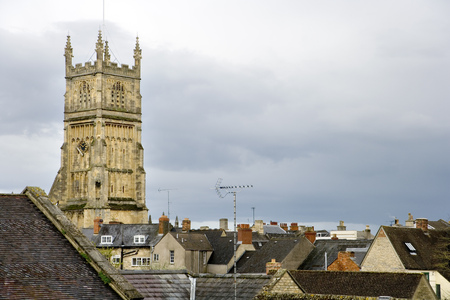 England, Cotswolds, Gloucestershire, view over the old rooftops of Cirencester to the historic Abbey Church