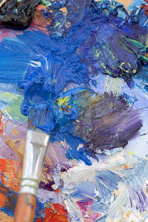 Artists oil paints and brush multi coloured close up semi abstract