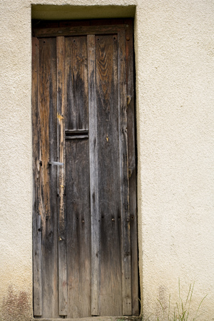 Ancient weathered house door Stock Photo