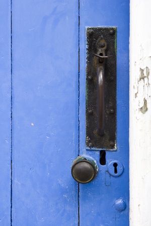 Old blue painted outbuilding door, latch and knob