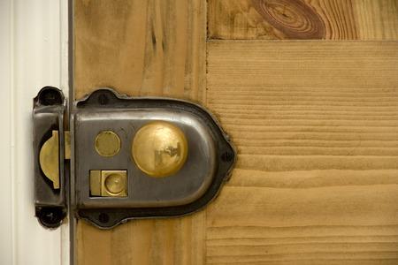Old style door knob on a closed door