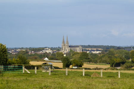 The cathedral at Sees seen across fields, Orne, Normandy, France Stock Photo