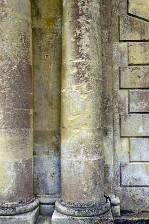 Classical architecture close up detail of old distressed stone coloumns Stock Photo
