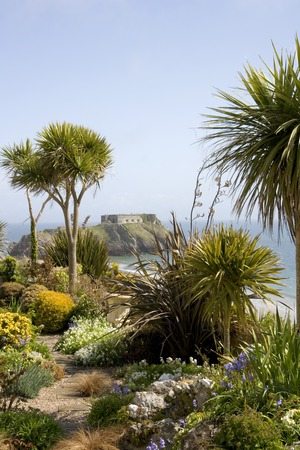 UK, Wales, Pembrokeshire, Tenby, seafront gardens and view to St Catherines Island Stock Photo