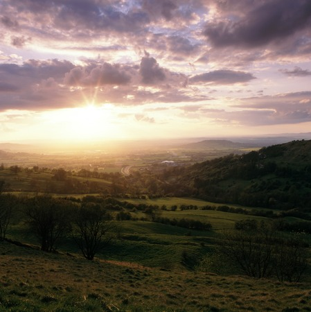 England, Cotswolds, Gloucestershire, sunset view from Birdlip Hill over the Severn Vale and Gloucester Stock Photo