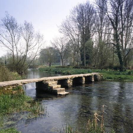 England, Cotswolds, Gloucestershire, Eastleach, River Leach, ancient clapper bridge 写真素材