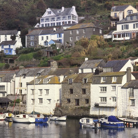 England, Cornwall, Old stone cottages on the hillside above Polperro Harbour