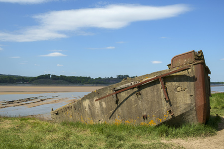 Obsolete old boats and barges were stranded on the banks of the tidal River Severn in Gloucestershire, UK to protect the river banks from erosion. Now they form an atmospheric local attraction to sightseers.