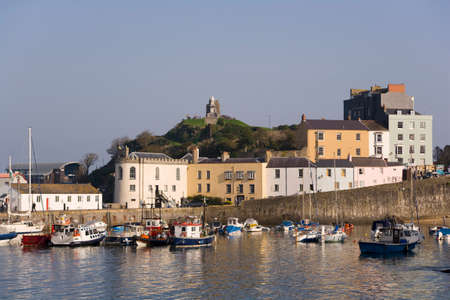 Colourful buildings around the harbour in autumn sunshine, Tenby, Pembrokeshire, Wales, UK