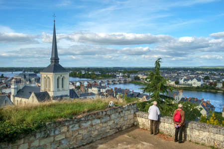 Saumur, France - 6th October 2017: Rooftops view over the city and River Loire on a beautiful sunny autumn afternoon in Saumur, Maine et Loire, France