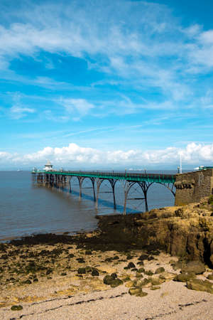 Clevedon, Somerset, UK - 11th September 2016: Late summer sunshine brings visitors to the historic Victorian pier at Clevedon on the Bristol Channel, Somerset, UK. The pier opened in 1869 and was an embarkation point for paddle steamer excursions.