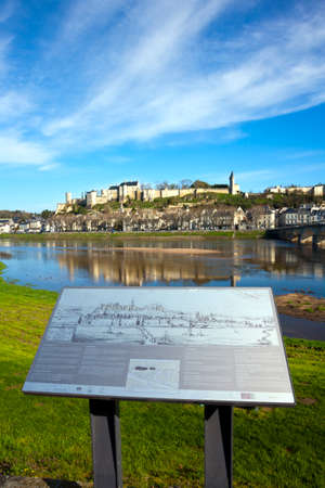 27th March 2017 - Chinon, FRance: Beautiful spring morning sunshine in Chinon town and chateau on the hill above by the banks of the Vienne River, Indre-et-Loire, France. The information board describes features of the view in several languages but has be Editorial