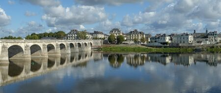 Reflections in a tranquil River Loire on a sunny autumn day in Saumur, Maine et Loire, France