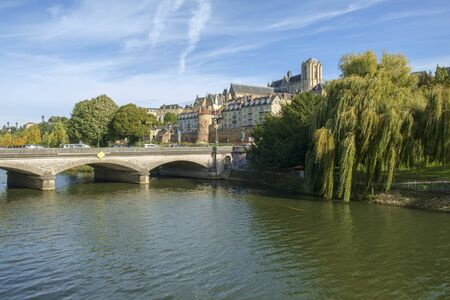 Buildings of old town Le Mans line the River Sarthe in afternoon sun, Le Mans, Sarthe, Loire Valley, France Stock Photo