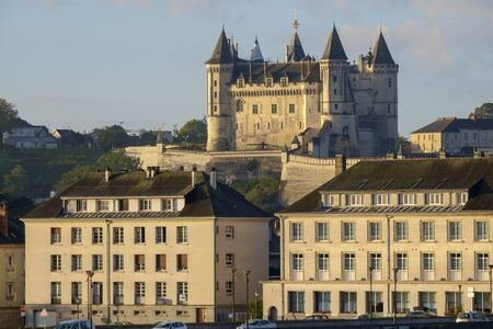 Telephoto view across the city to Chateau de Saumur in early morning autumn sunshine, Saumur, Maine et Loire, France