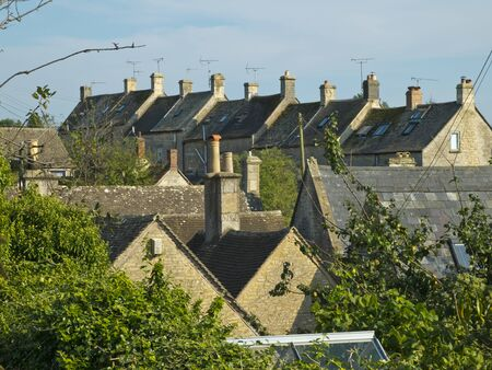 Higgledy-piggledy rooftops in quaint Bisley village, The Cotswolds, Gloucestershire, UK Фото со стока