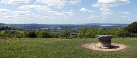 Panoramic views over the Severn Vale from The Cotswold Way long distance footpath near the toposcope at Standish Wood, Stroud, Gloucestershire, Cotswolds, UK