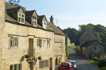 Quaint Cotswold stone cottages line the streets of Bisley, Gloucestershire, UK