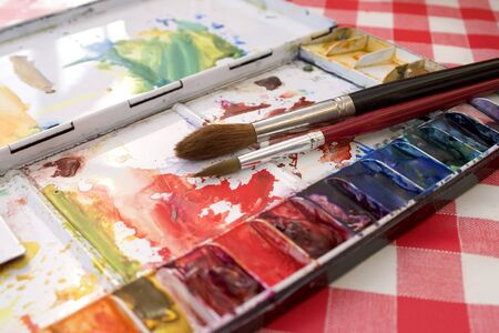 Artists watercolour paint palette close up