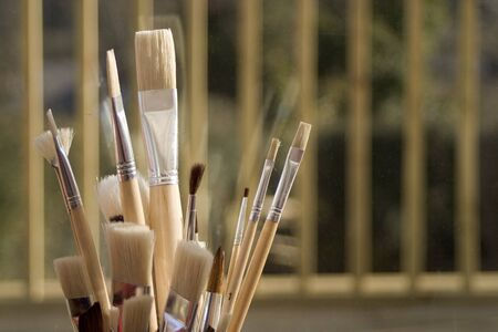 Artists paint brushes in pot
