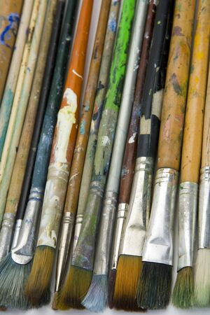 Well used artists oil painting brushes close-up background