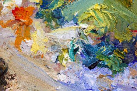Multi coloured artists oil paint palette close up