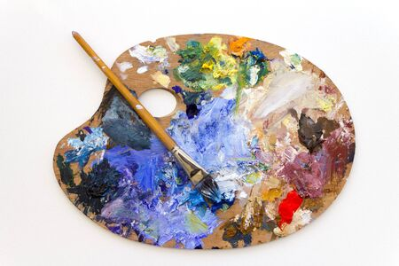 Vibrant multi-coloured artists oil paint palette
