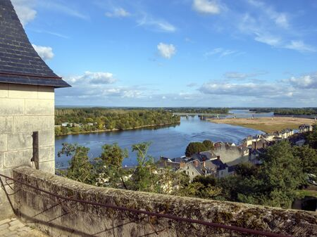 Rooftops view over the city and River Loire on a beautiful sunny autumn afternoon in Saumur, Maine et Loire, France Banque d'images