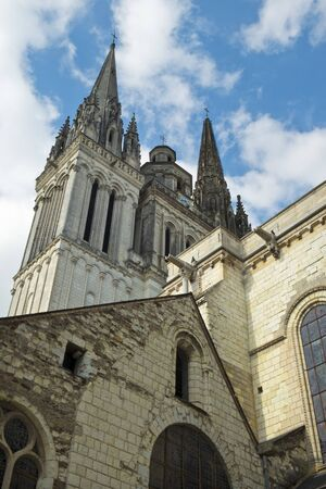 Looking up at the twin spires of Cathedral St Maurice in spring sunshine, Angers, Maine et Loire, France