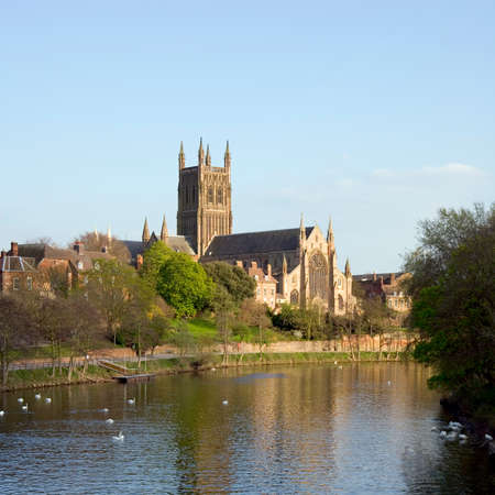England, Worcestershire, the River Severn flowing past Worcester Cathedral in spring sunshine Reklamní fotografie