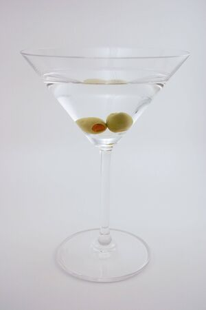 Martini with two olives isolated on an off-white background Stock Photo - 3098185