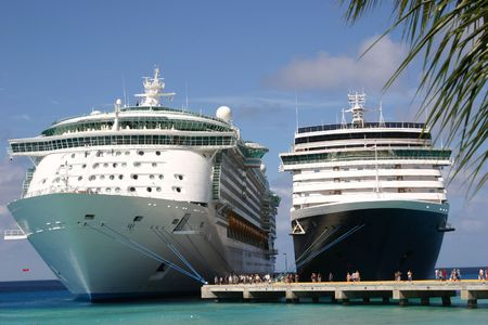 liner: Two Cruise Ships docked Side by Side