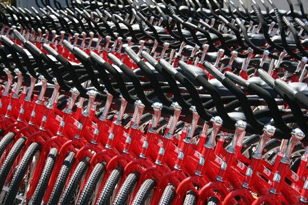 Several rows of red bicycles