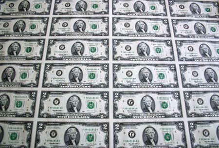 An uncut sheet of two dollar bills
