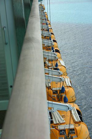 Lifeboats on a Cruise Ship shot with Diminishing Perspective Stock Photo - 3101655