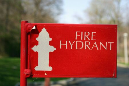 A red sign indicating a fire hydrant Stock Photo