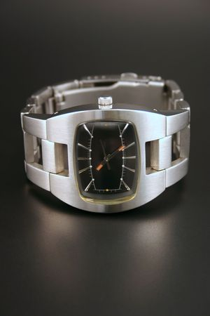 A silver metallic watch islolated on a black background Stock Photo