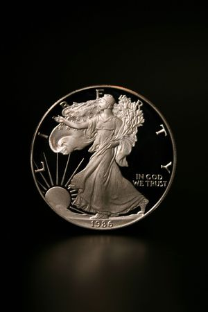 american silver eagle: One American Eagle Silver Bullion Coin (legal tender) lit from above