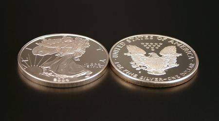 minted: Two American Eagle Silver Bullion Coins (legal tender) showing the front and back of the coin