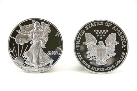 Two American Eagle Silver Bullion Coins (legal tender) showing the front and back of the coin