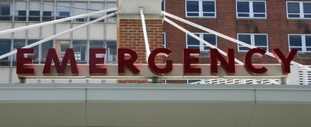 An Emergency sign above the entrance to an Emergency Room Stock Photo
