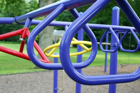 A set of children's swinging bars in a playground