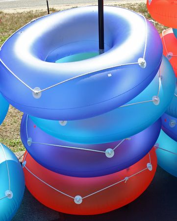 A stack of colorful inflatable rings in the sun Stock Photo