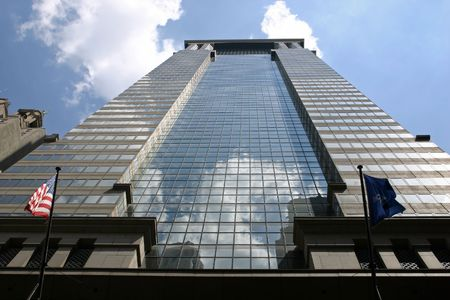 A glass skyscraper located in the financial district of NYC