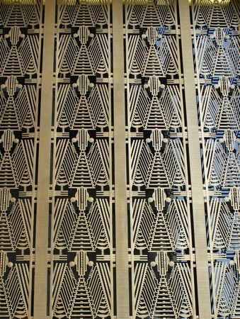 The Art Deco pattern above the entrance to a skyscraper in NYC Stock Photo
