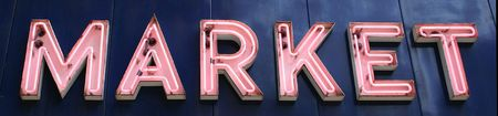 A pink neon sign that reads Market