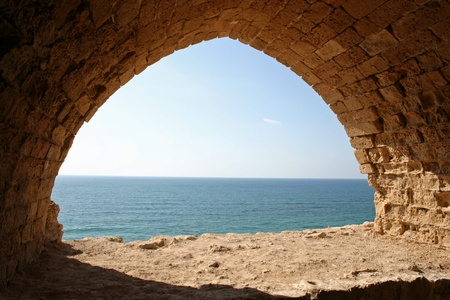 Looking through an archway onto the Mediterranean Sea at Apollonia National Park in Herzliya, Israel Stock Photo