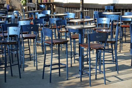 Empty tables at an outdoor cafe Stock Photo
