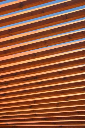 spindles: Wooden spindles in an overhead structure