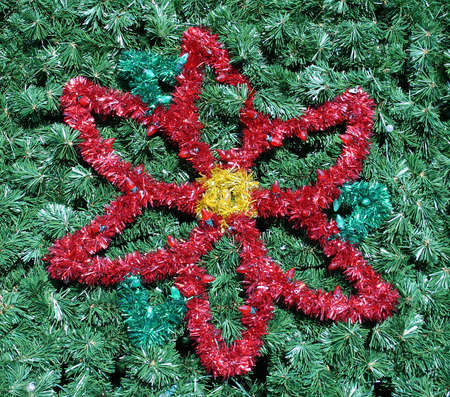 fake christmas tree: A red flower in a green christmas tree